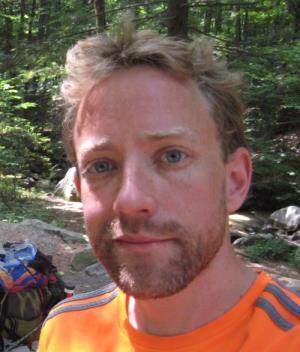 MgA. Conrad Eric Armstrong